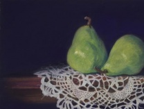 A photo of Two Green Pears on Antique Doily