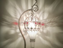 Photo of Glass hot air balloon table lamp made from stadium lightbulb. Decorated with copper and brass.